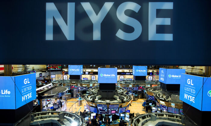 Traders work on the floor at the New York Stock Exchange (NYSE) in New York, on Aug. 12, 2019. (Eduardo Munoz/File Photo/Reuters)