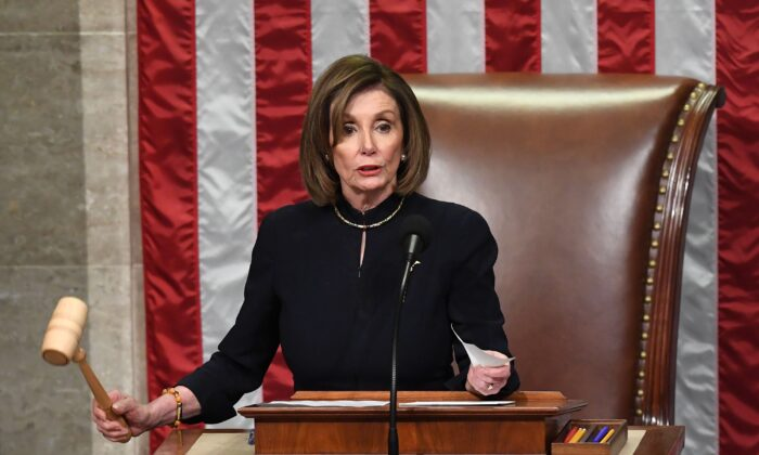 Speaker of the House Nancy Pelosi presides over Resolution 755, Articles of Impeachment Against President Donald Trump as the House votes at the U.S. Capitol in Washington, on Dec. 18, 2019. (Saul Loeb/AFP via Getty Images)