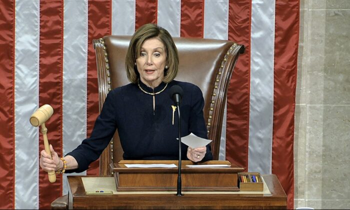 House Speaker Nancy Pelosi (D-Calif.) announces the passage of the first article of impeachment, abuse of power, against President Donald Trump by the House of Representatives at the Capitol in Washington, on Dec. 18, 2019. (House Television via AP)
