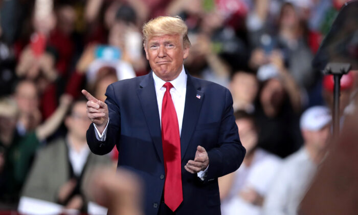 President Donald Trump hosts a Merry Christmas Rally at the Kellogg Arena in Battle Creek, Mich., on Dec. 18, 2019. (Scott Olson/Getty Images)