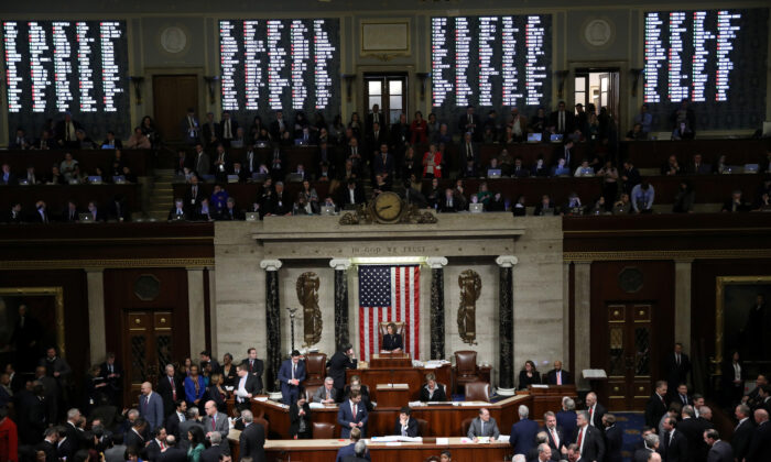 A tote board shows the votes of members of Congress as U.S. Speaker of the House Nancy Pelosi (D-Calif.) presides over the final of two House of Representatives votes approving two counts of impeachment against President Donald Trump in the House Chamber of the U.S. Capitol in Washington, on Dec. 18, 2019. (Jonathan Ernst/Reuters)
