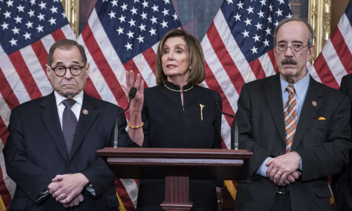 House Speaker Nancy Pelosi (D-Calif.) delivers remarks alongside House Judiciary Chairman Jerry Nadler (D-N.Y.) and House Foreign Affairs Chairman Eliot Engel (D-N.Y.) following the House of Representatives vote to impeach President Donald Trump in Washington on Dec. 18, 2019. (Sarah Silbiger/Getty Images)
