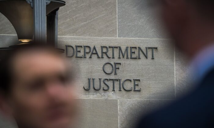 "A ""Department of Justice"" sign is seen on the wall of the US Department of Justice building in Washington, on April 18, 2019. (Chandan Khanna/AFP via Getty Images)"