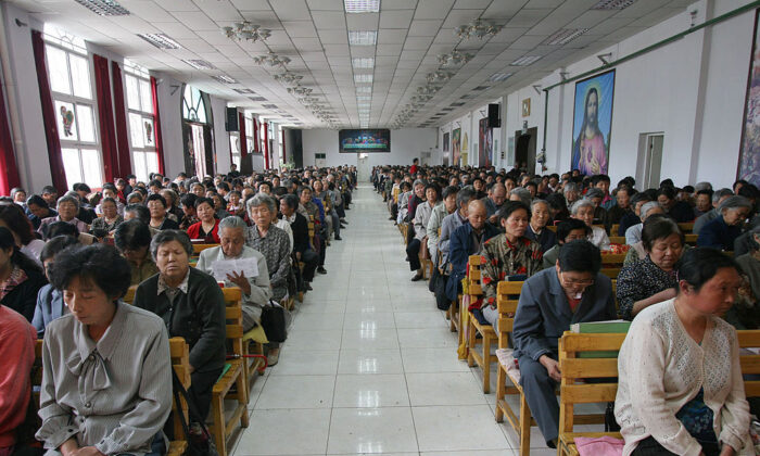 Christians pray during a mass at a church in Xining in China's northwest Qinghai Province, on July 3, 2005. China officially sanctions five religious groups: Protestantism, Catholicism, Islam, Buddhism and Taoism. The Chinese are allowed to worship only in state-sanctioned churches and temples. (China Photos/Getty Images)