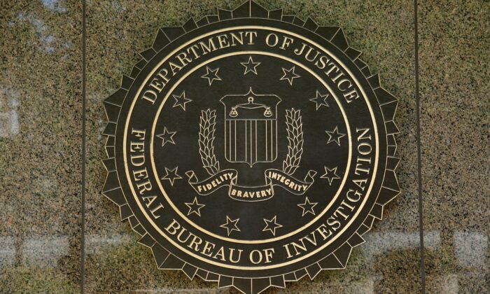 The FBI seal is seen outside the headquarters building in Washington, DC on July 5, 2016. (YURI GRIPAS/AFP via Getty Images)