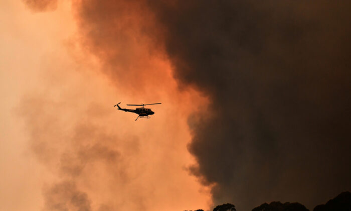 A helicopter is seen during a bushfire near Bilpin, 90 km north west of Sydney, Australia, Dec. 19, 2019. (AAP Image/Mick Tsikas/via Reuters)