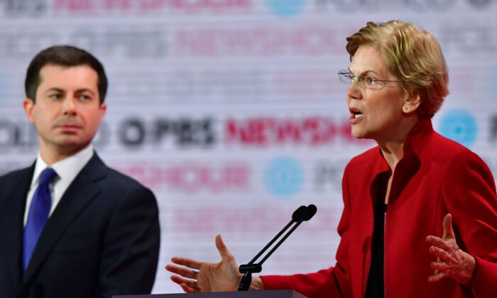 Democratic presidential hopefuls Sen.  Elizabeth Warren (D-Mass.) speaks as and South Bend Mayor Pete Buttigieg looks on during the sixth Democratic primary debate of the 2020 presidential campaign season at Loyola Marymount University in Los Angeles, California on Dec. 19, 2019. (Frederic J. Brown/AFP via Getty Images)