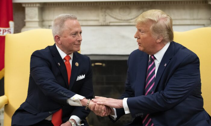 Rep. Jeff Van Drew (R-N.J.) meets with President Donald Trump in the Oval Office of the White House in Washington on Dec. 19, 2019. (Drew Angerer/Getty Images)