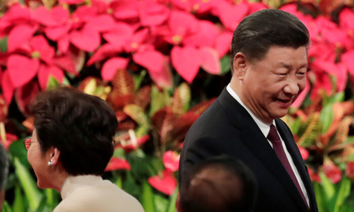 Chinese President Xi Jinping and Hong Kong Chief Executive Carrie Lam attend a ceremony to celebrate the 20th anniversary of the former Portuguese colony's return to Chinese rule, in Macau, China, on Dec. 20, 2019. (Jason Lee/Reuters)