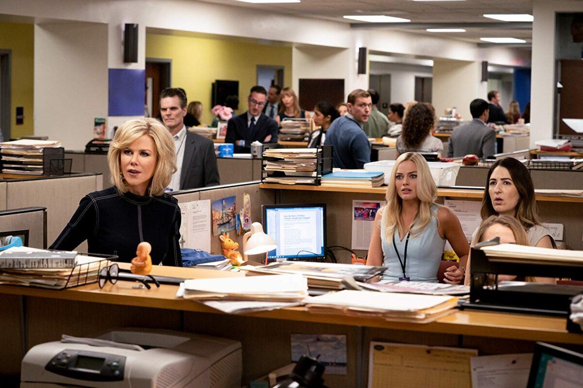 women at desk in newsroom