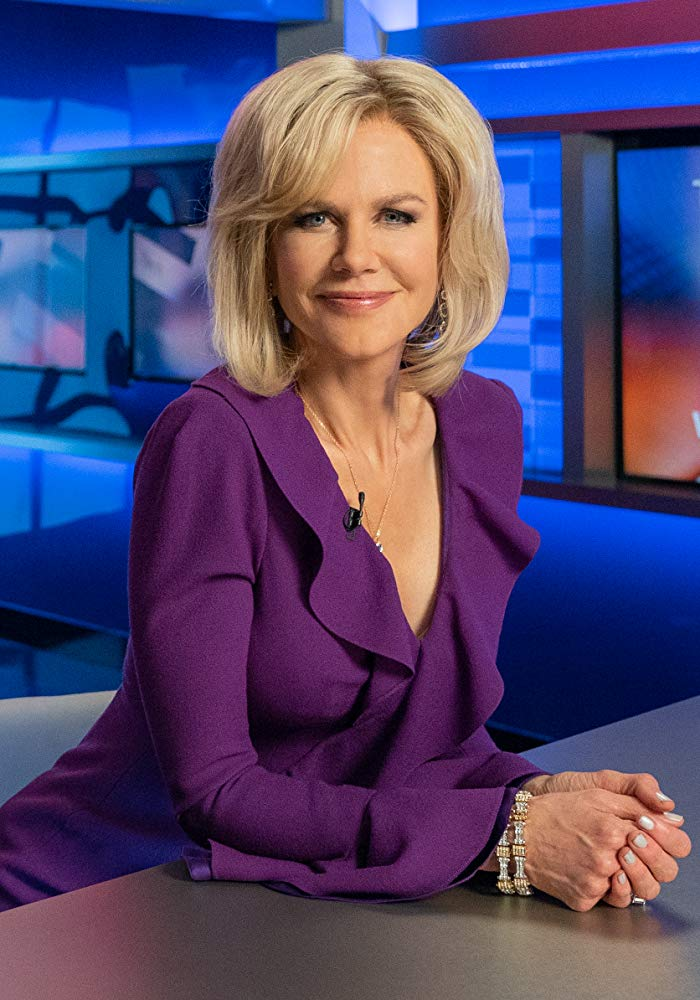 blonde female news anchor in purple dress
