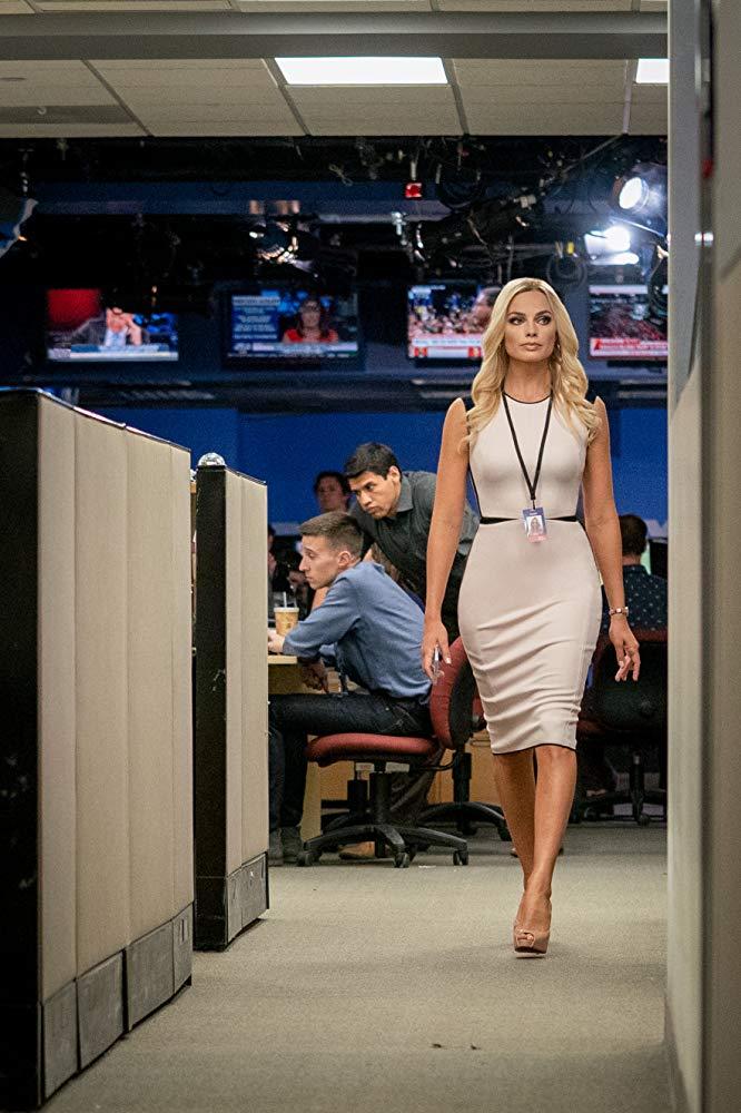 blond woman in beige dress