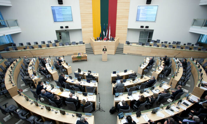 Lithuanian Parliament (Seimas) Hall. Members of the Parliament participate in the 31st Session of the Baltic Assembly in Vilnius, the capital of Lithuania on Nov. 9, 2012. (Saeima [CC BY-SA 2.0] https://creativecommons.org/licenses/by-sa/2.0)