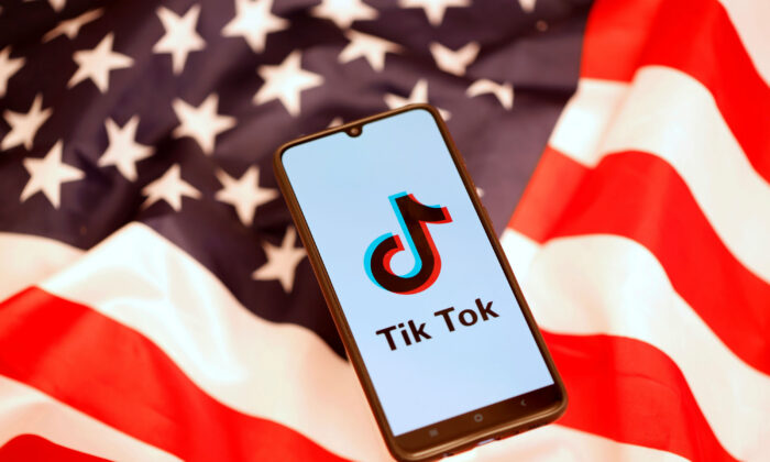 TikTok logo is displayed on the smartphone on the U.S. flag on Nov. 8, 2019. (Reuters/Dado Ruvic)