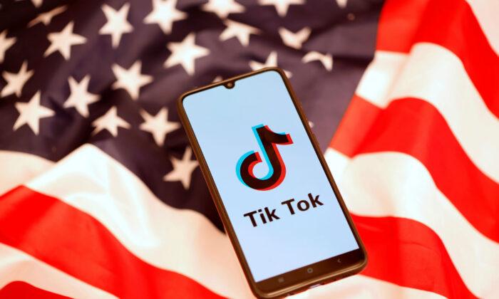 TikTok logo displayed on a smartphone on the U.S. flag on Nov. 8, 2019. (Reuters/Dado Ruvic)