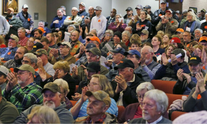 Spectators applaud as the Buckingham County Board of Supervisors unanimously voted to pass a Second Amendment Sanctuary City resolution at a meeting in Buckingham , Va., Monday, Dec. 9, 2019. (Steve Helber/AP Photo)