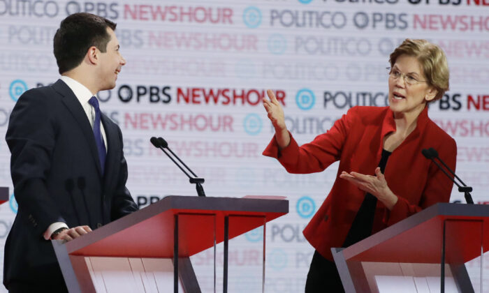 Democratic presidential candidate Sen. Elizabeth Warren, D-Mass., speaks as South Bend Mayor Pete Buttigieg listens during a Democratic presidential primary debate in Los Angeles on Dec. 19, 2019. (Chris Carlson/AP Photo)