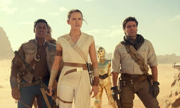 "(L–R) John Boyega, Joonas Suotamo (behind), Daisy Ridley,  Anthony Daniels, and Oscar Isaac star in the lastest and possibly final ""Star Wars"" film. (2019 Lucasfilm Ltd.)"