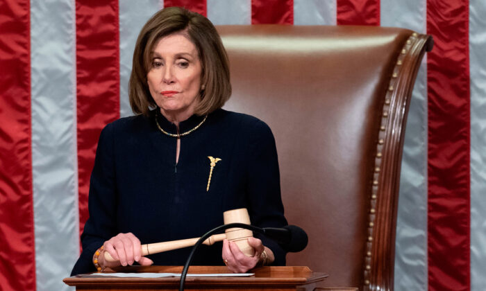 House Speaker Nancy Pelosi presides over Resolution 755, Articles of Impeachment Against President Donald Trump as the House votes at the Capitol in Washington, on Dec. 18, 2019. (Saul Loeb/AFP via Getty Images)