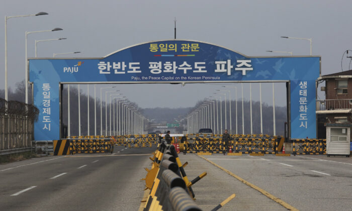 In this Dec. 16, 2019, photo, South Korean army soldiers stand guard at the Unification Bridge, which leads to the Panmunjom in the Demilitarized Zone in Paju, South Korea. (AP Photo/Ahn Young-joon)