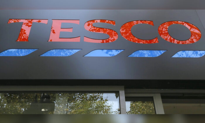 The sign on a Tesco shop is photographed, in London, on Sept. 22, 2014. (Kirsty Wigglesworth/AP Photo)