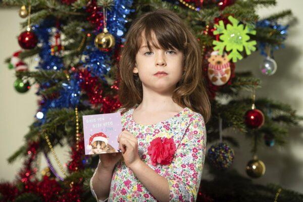 girl holding Christmas card