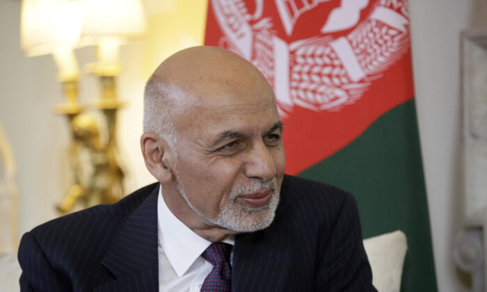 Afghanistan's President Ashraf Ghani speaks with British Prime Minister Theresa May at the start of their meeting inside 10 Downing Street in London on June 17, 2019. June 17, 2019. (Matt Dunham/AP/Pool-File)