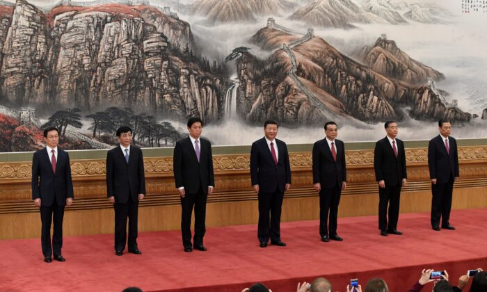 The Chinese Communist Party's Politburo Standing Committee members (L-R): Han Zheng, Wang Huning, Li Zhanshu, Chinese leader Xi Jinping, premier Li Keqiang, Wang Yang, and Zhao Leji meet the press at the Great Hall of the People in Beijing on October 25, 2017. (WANG ZHAO/AFP via Getty Images)