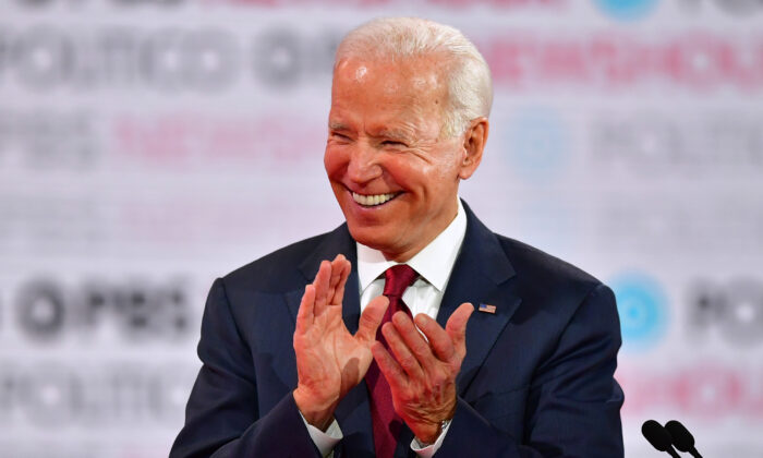 Democratic presidential hopeful former Vice President Joe Biden laughs during the sixth Democratic primary debate of the 2020 presidential campaign season at Loyola Marymount University in Los Angeles, California on Dec. 19, 2019. (Frederic J. Brown/AFP via Getty Images)