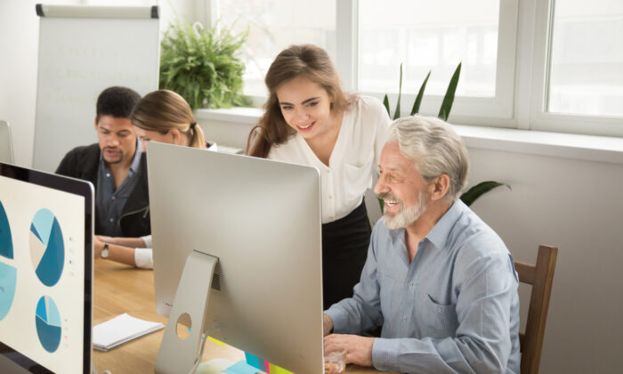 """Young workers should work to form relationships with older colleagues or even engage in """"reverse mentorships,"""" helping an older worker learn a new technology skill. (Shutterstock)"""