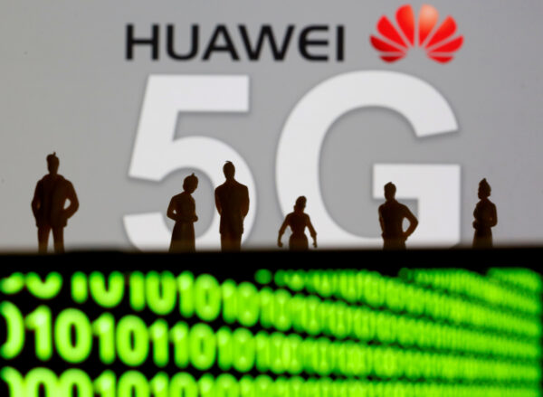 Huawei and 5G logos are shown with with sihouetted figures