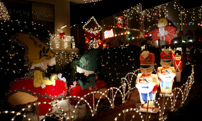 Christmas decorations fill a yard in Pasadena, Calif., on Dec. 17, 2003. (David McNew/Getty Images)