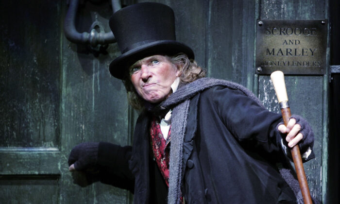 Actor Tommy Steele poses at a photocall to promote his role as Ebenezer Scrooge at the London Palladium in London, on Oct. 27, 2005.  M.J. Kim/Getty Images