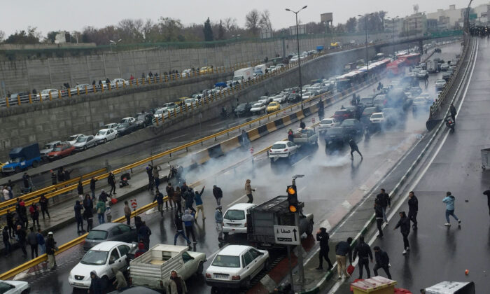 People protest against increased gas price, on a highway in Tehran, Iran, on Nov. 16, 2019. (Nazanin Tabatabaee/WANA (West Asia News Agency) via Reuters)