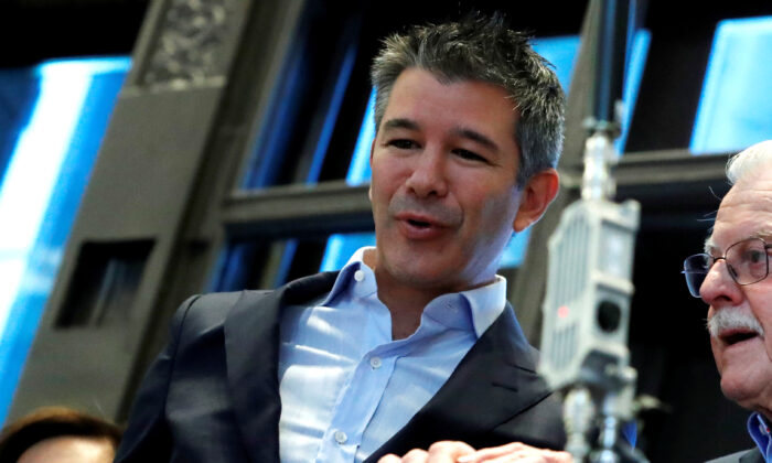 Former Uber CEO and co-founder Travis Kalanick stands on a balcony above the trading floor of the New York Stock Exchange (NYSE) during the company's IPO in New York City, on May 10, 2019. (Andrew Kelly/Reuters)