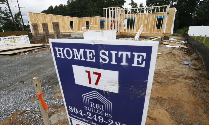 A new home is under construction in Mechanicsville, Va., on June 13, 2019. (AP Photo/Steve Helber)