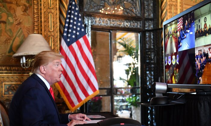 President Donald Trump makes a video call to troops stationed worldwide at the Mar-a-Lago estate in Palm Beach Florida, on Dec. 24, 2019. (Nicholas Kamm/AFP via Getty Images)