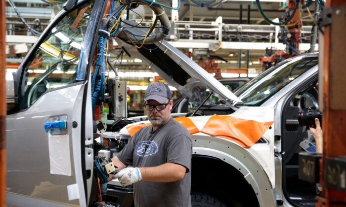 An employee works on the assembly line for the Ford 2018 and 2019 F-150 truck at the Ford Motor Company's Rouge Complex in Dearborn, Michigan, on Sept. 27, 2018. (Jeff Kowalsky/AFP via Getty Images)