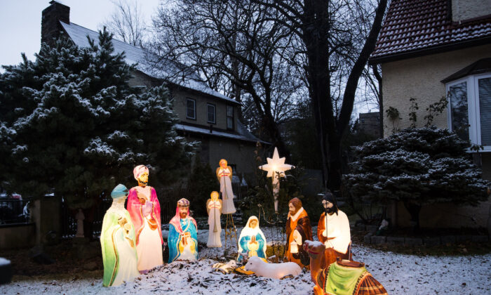 Christmas decoration covered with snow is seen on a house gate in Riverdale neighborhood of the Bronx borough of New York City on Dec. 25, 2017. (Amir Levy/Getty Images)