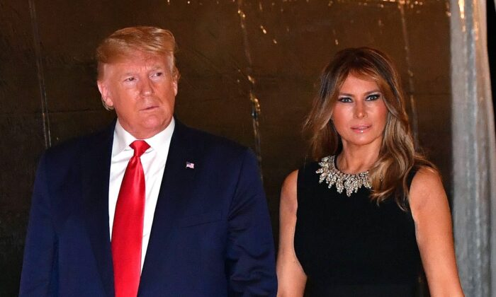President Donald Trump and First Lady Melania Trump arrive for a Christmas Eve dinner with family at Mar-A-Lago in Palm Beach, Fla., on Dec. 24, 2019. (Nicholas Kamm/AFP via Getty Images)