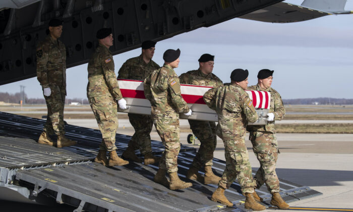 An Army carry team moves a transfer case containing the remains of U.S. Army Sgt. 1st Class Michael Goble, at Dover Air Force Base, on Wednesday, Dec. 25, 2019,  (Alex Brandon/AP)