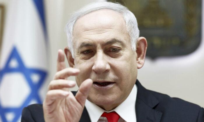 Israeli Prime Minister Benjamin Netanyahu reacts during the weekly cabinet meeting, at his office in Jerusalem on Dec. 15, 2019. (Gali Tibbon/Pool via AP)