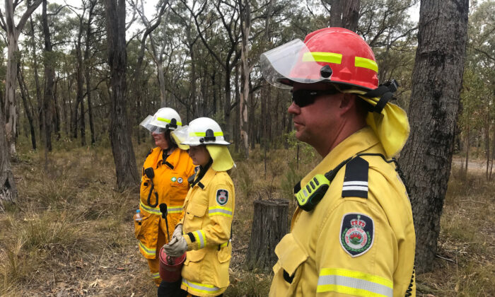 New South Wales Rural Fire Service observers during back burnning operations near Picton, Australia Dec. 22, 2019. (Reuters/Jill Gralow)