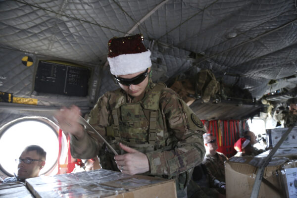 A U.S. soldier secures Christmas gifts