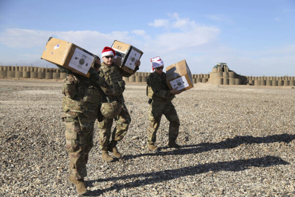U.S. soldiers deliver Christmas gifts