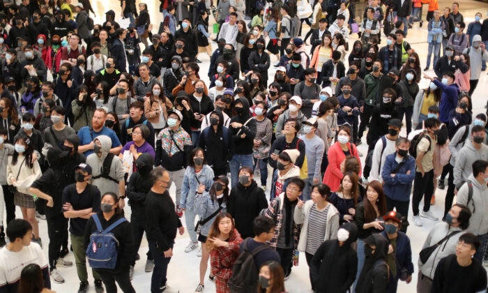 Hong Kong protesters attend a Christmas Day rally in Sha Tin shopping mall in Hong Kong, China on Dec. 25, 2019. (Lucy Nicholson/Reuters)