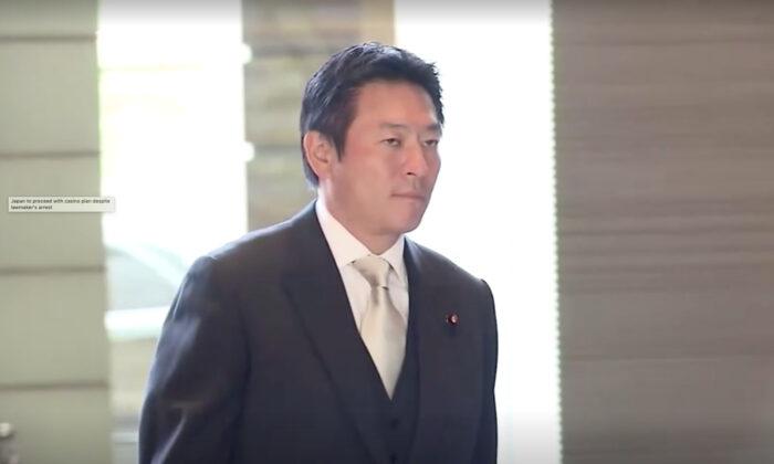 Japanese lawmaker Tsukasa Akimoto walking at entrance of prime minister's office on Dec. 26, 2019. (Screenshot/TV Tokyo via Reuters)