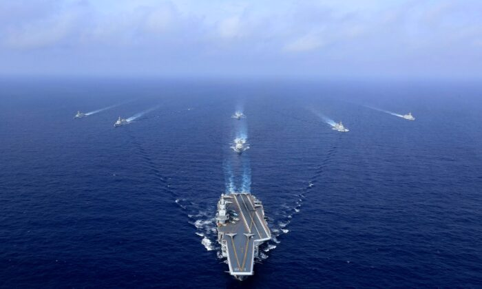 China's Liaoning aircraft carrier (C) at a military drill at sea on April 18, 2018. (AFP via Getty Images)