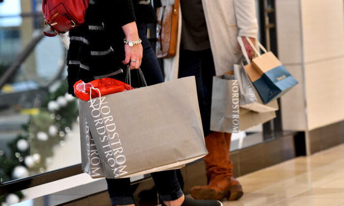 Shoppers clutch their Nordstrom bags as pre-Thanksgiving and Christmas holiday shopping accelerates at the King of Prussia Mall in King of Prussia, Pa., on Nov. 22, 2019. (Mark Makela/Reuters)