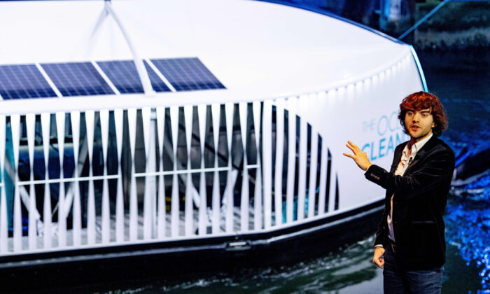 """Boyan Slat, the Dutch founder and CEO of The Ocean Cleanup, presents in Rotterdam the new barge system called """"The Interceptor"""" which will be used for the expansion of their river and ocean cleaning campaign on Oct. 26, 2019.  Robin Utrecht/ANP/AFP via Getty Images"""